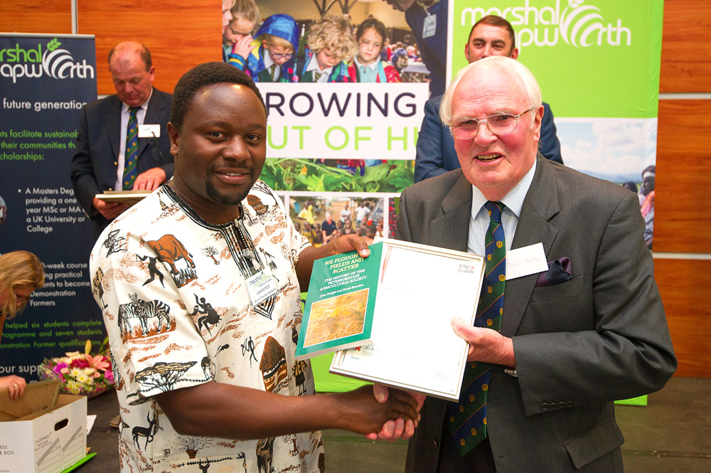 Julian Proctor presents Lawrence with his certificate