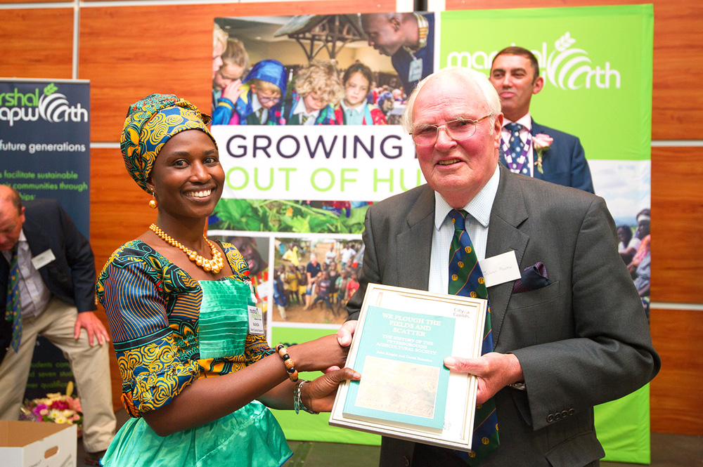 Julian Proctor presents Rashida with her certificate