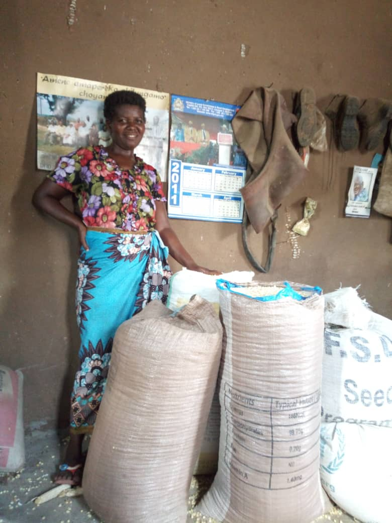 Text Box:   Mary at home with some of her maize yield.